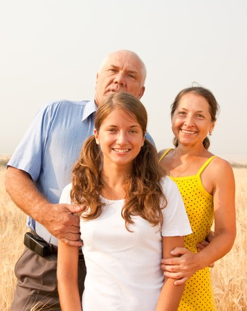 Family of Three in a field of wheat Stock Photo - 7506715