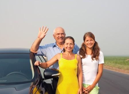 Family near black car at road outdoor Stock Photo - 7506720