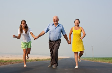 runing: Happy family on summer countryside. freedom concept