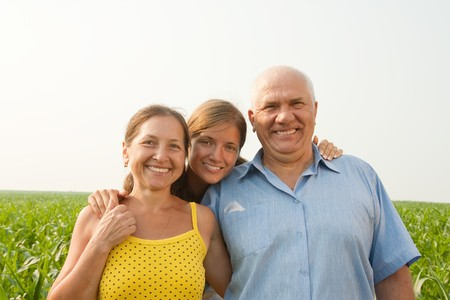 Portrait of Family of Three in a Meadow Stock Photo