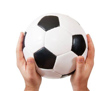 futbol: pallone da calcio classico nelle mani maschile. Isolato over white  Archivio Fotografico