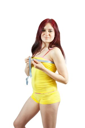 ladies bust: Girl measuring bust with a tape measure Isolated on white