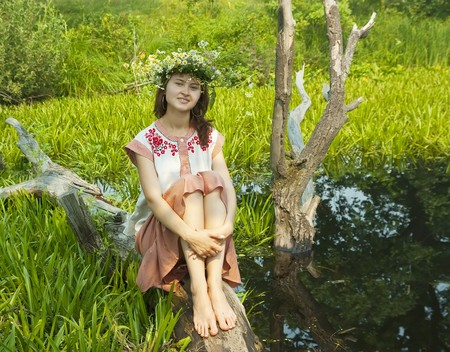 undine: girl  in russian traditional clothes in lake