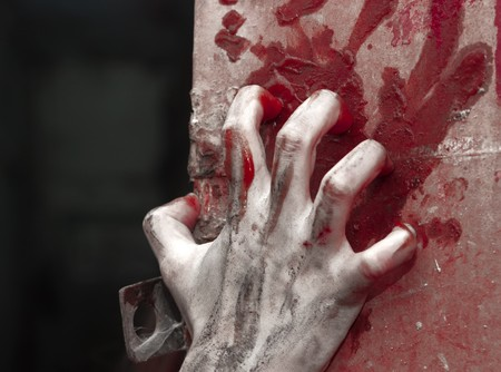 terror: a horror hand over background with claret