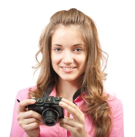Jeune fille avec caméra isolé sur blanc