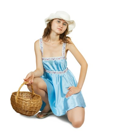 Attractive young girl with basket  sitting on white background