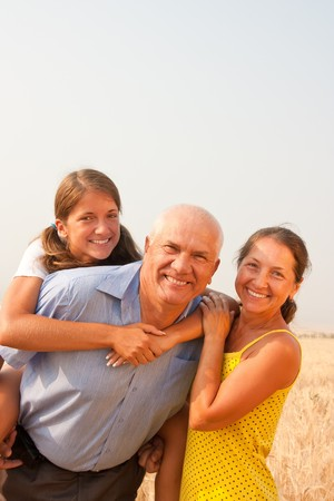 Senior father and mother whith teen daughter outdoor  Stock Photo - 7818679
