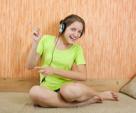 househould: young woman listen to the music with head phones