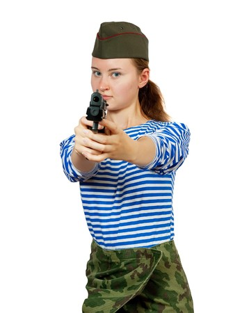 Army girl in garrison cap posing over white background photo
