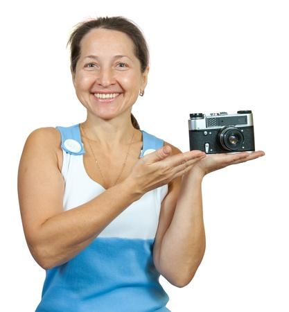 Senior female photographer, isolated over white background photo