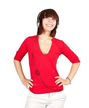 teener: Young   happy girl listening music in headphones over white