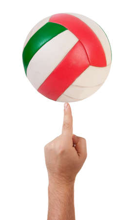 The volleyball ball on finger  isolated over white Stock Photo - 8662509