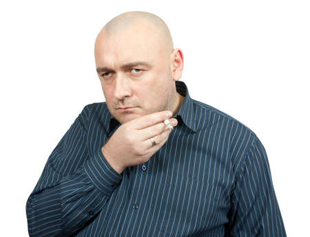 lamentable: Sad smoking man. Isolated on white backdrop Stock Photo