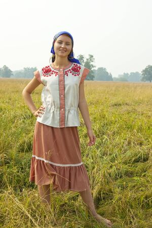 girl in traditional clothes  aganst summer nature photo