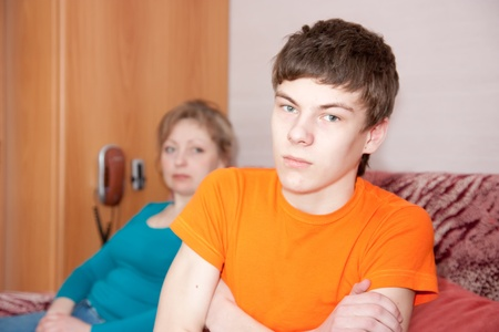 teen  son and mother having quarrel at home