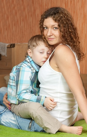 Mother comforting four year old son photo