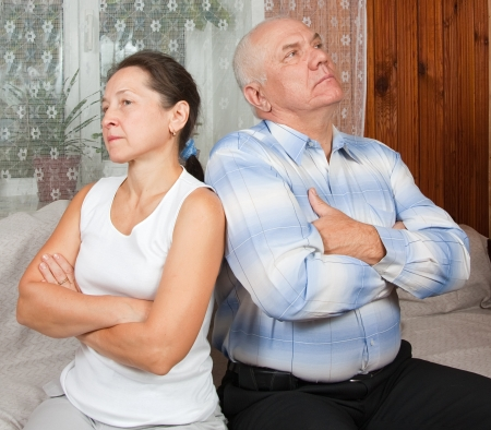 mature couple having a fight, at home on sofa  Stock Photo