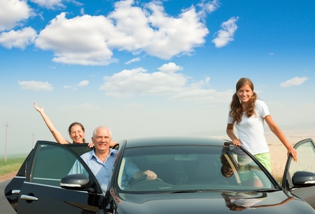 Happy family of three  by �ar on road Stock Photo