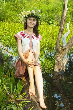 undine: girl  in russian traditional clothes in river