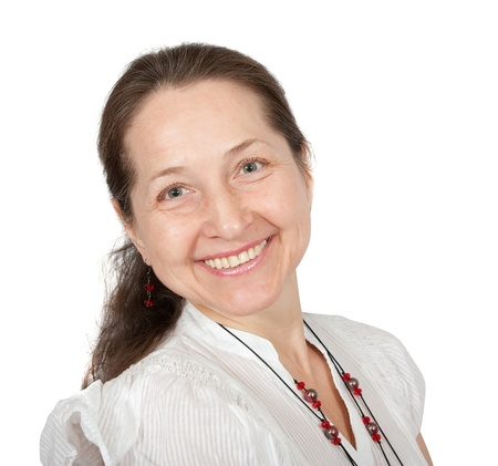 Portrait of happy mature woman smiling against white background Stock Photo - 9212363