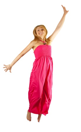 traditionary: middle-aged woman in pink tunic jumping