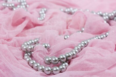 jewels on pink satin as a background photo