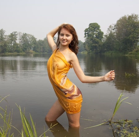 beauty naked girl in  wet against river photo