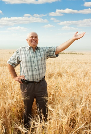 Happy senior man in field  . Concept Welcom