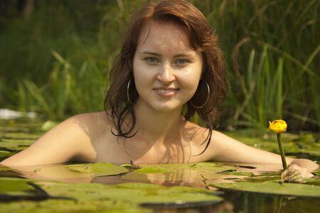 beauty girl poising against river  photo