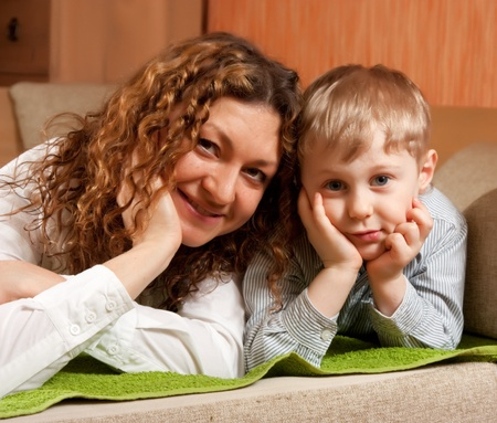 mother with her son in home interior photo