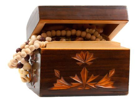 Wooden jewelry box with accessories  made of wood photo