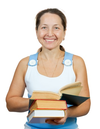 armful: Cheerful mature woman with an armful of books