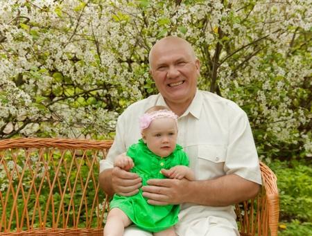 grandad: Senior grandad with his granddaughter outdoor in spring day