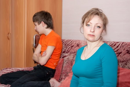 teen  son and mother having quarrel at home photo