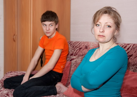 fracas: Mother and teen  son having quarrel at home Stock Photo