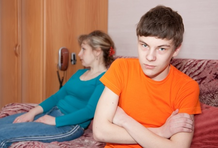 Mature mother and son after quarrel at home Stock Photo