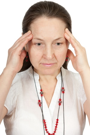 cephalgia: Mature woman suffering from headache isolated against a white background Stock Photo