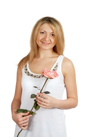traditionary: Portrait of  middle aged woman with   rose isolated on white background