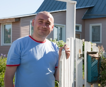 Hospitableadult man in front of his house Stock Photo