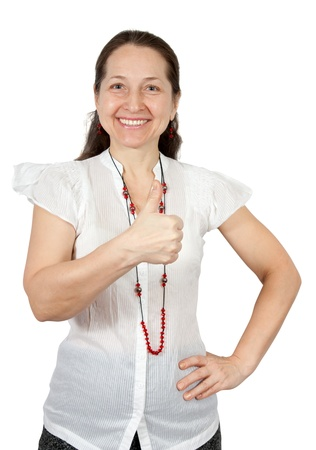 all right: Portrait of a smiling mature female standing against white background