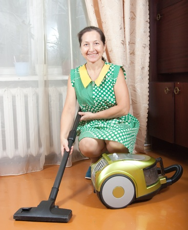 Housework, vacuum cleaner, mature woman, home photo