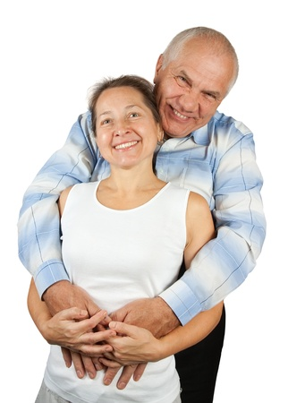 Portrait of handsome mature man hugging his wife from behind against white background
