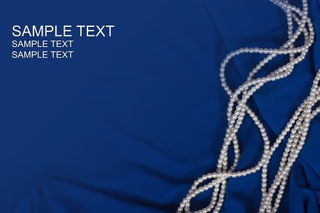 pearl background:   luxury background of jewels on blue fabric