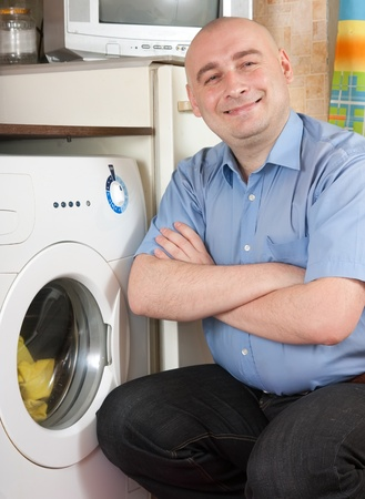 Man with washing machine at his home Stock Photo - 12587015