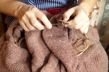 close-up of midaged womans hands  knitting with colorful wool Stock Photo