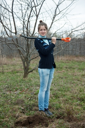 pastoral: Happy pastoral  woman   with shovel in spring