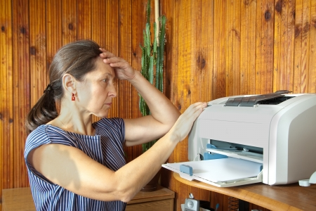 broken home:   woman printing on the printer  at home.breakage