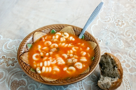 Delicious soup with meat and pasta photo