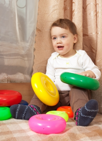 1 2 month: Little toddler is playing with toy blocks Stock Photo