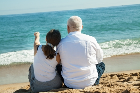 mature couple together at sea beach